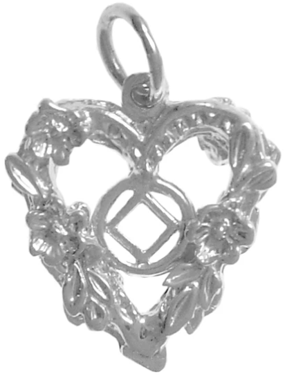 NA Symbol in the Center of a Open 2 Sided Heart with Flowers